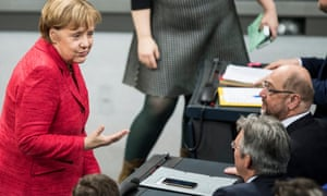 Angela Merkel talks to Martin Schulz