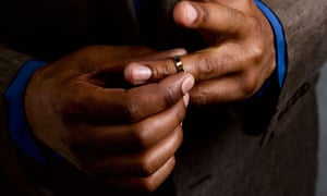 Man taking wedding ring off
