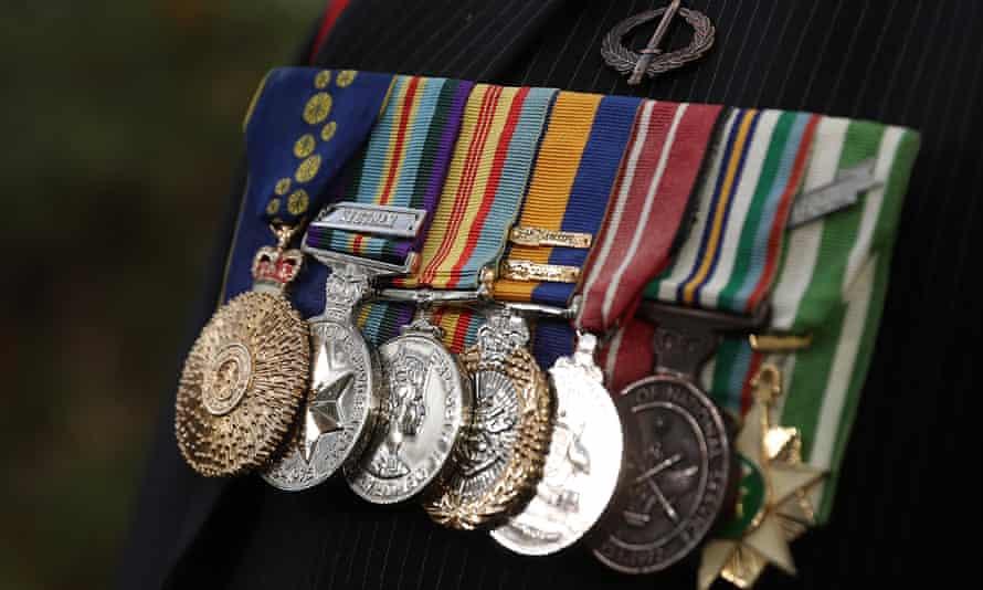 The service medals on uniform of a war veteran