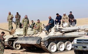 Peshmerga forces take part in an operation to the south-east of Mosul.