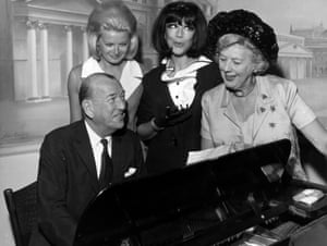The stars of the musical comedy, High Spirits – based on Noel Coward's play Blithe Spirit – Jan Waters, Fenella Fielding and Cicely Courtneidge, gather around the piano with the author for a song on 7 September 1964
