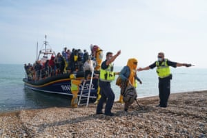 People are brought ashore from a lifeboat at Dungeness in Kent.