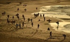Surfers and swimmers head to the ocean after Bondi Beach reopened following a five week closure in Sydney on Tuesday.