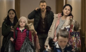 Still from the film Rosie showing the family carrying all their belongings
