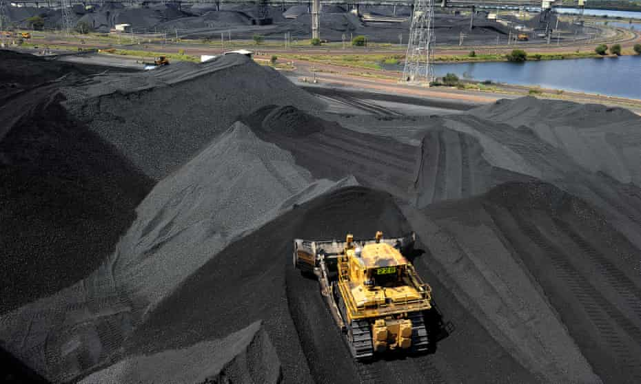 Coal is stockpiled before being loaded on to ships in Gladstone, Australia