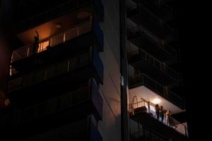 People are seen on balconies of an apartment building in El Condado tourist zone in San Juan, Puerto Rico, US