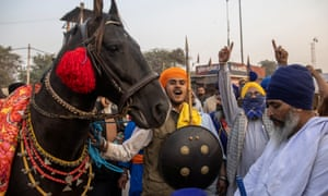 A Nihang (Sikh warrior) at a protest against the newly passed farm bills, at the Singhu border near Delhi, India.