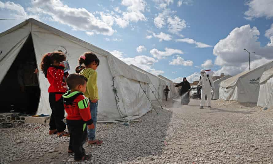 Syrian children by tent