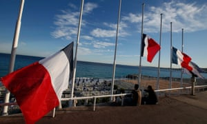 Flags fly at half-mast in tribute to victims the day after at least 84 people were killed celebrating the Bastille Day in Nice.