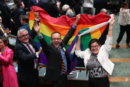 Cathy McGowan, Adam Bandt and Andrew Wilkie celebrate.