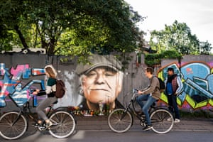Copenhagen, Denmark: Tributes are laid to the singer Kim Larsen, who died over the weekend aged 72, in front of a portrait painted on a fence in Christiania