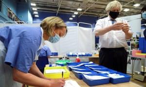 Boris Johnson visits a vaccination centre at Cwmbran stadium in south Wales.