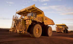 In Australia, the world's most truck-dependent nation, mining giants are using remote-controlled lorries to shift iron ore around massive mining pits.