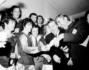 Doug Ellis looks on as Pat Matthews, the club president, pours champagne to celebrate Aston Villa's victory over Manchester United in the League Cup Semi-Final 2nd Leg at Villa Park, 1970.