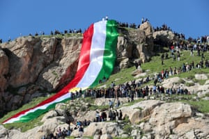 Duhok, Iraqi KurdistanIraqi Kurdish people drape a flag across a mountain, as they celebrate Nowruz Day, a festival marking the first day of spring and the new year, in the town of Akra.