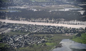 Low lying properties next to the swollen Fitzroy river in Rockhampton on Monday.