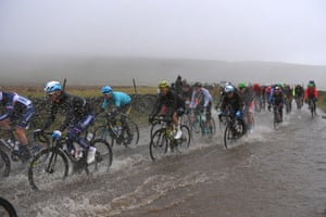 Cyclists ride through the rain during the men's race at the UCI Road World Championships