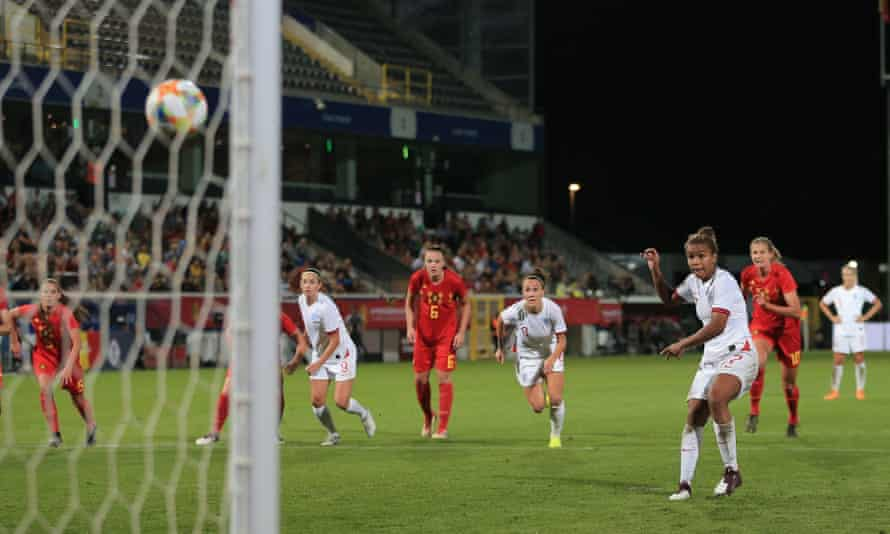 Nikita Parris of England scores her penalty to make it 3-3 in the friendly against Belgium in Leuven.