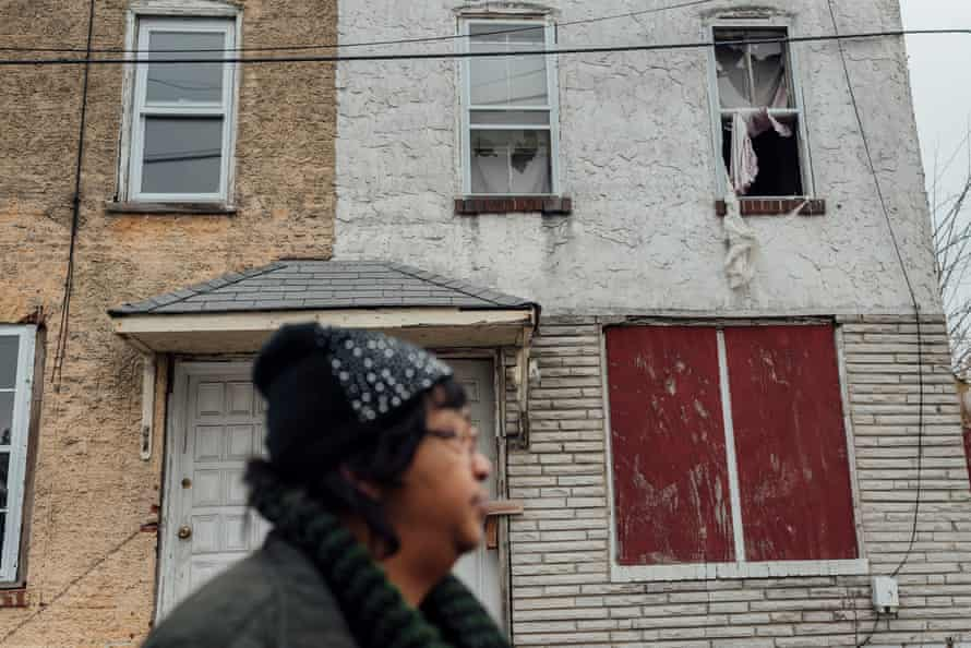 Zulene Mayfield stands in front of her old house in Chester, Pennsylvania. Mayfield moved to Delaware because she says she couldn't live in her home anymore despite still owning it