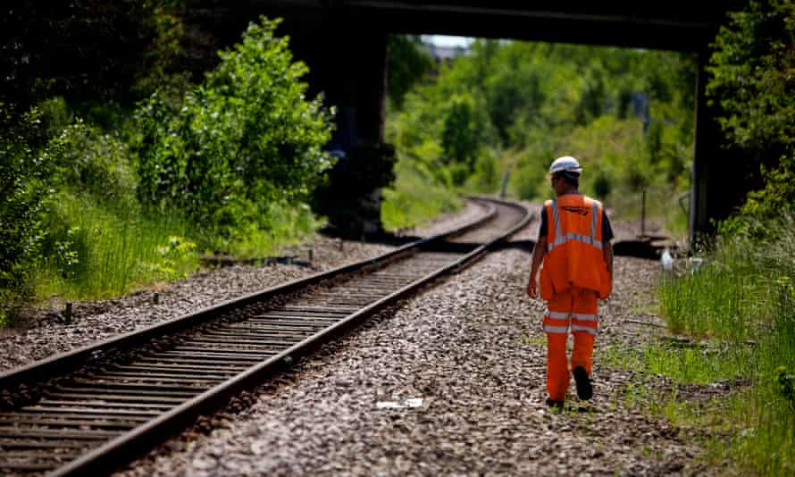 A Network Rail worker repairs and replaces stolen copper wiring.