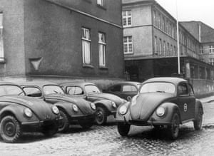 In 1945 the first Volkswagens, made in Bonneberg, West Germany, are parked in the factory's courtyard.