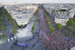 The Bus of France's World Cup Winning Team Parade Down The Champs Elysees in Paris