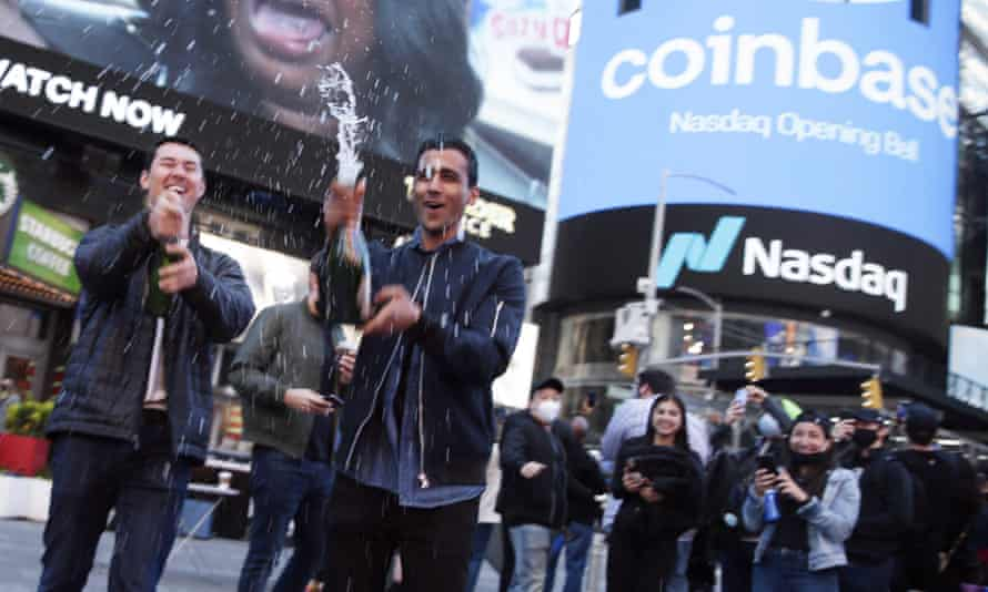 Employees and supporters of Coinbase celebrate in New York City on 14 April.