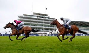 Safe Voyage ridden by jockey Jason Hart (left) wins the Investec Surrey Stakes.
