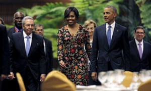 Michelle and Barack Obama attend a state dinner hosted by Cuban president Raúl Castro.