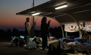 People pray at sunrise near a new temporary camp on the Greek island of Lesbos.