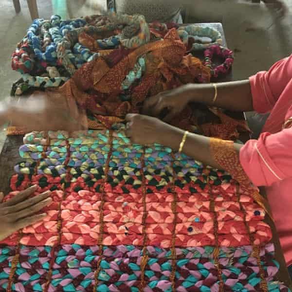 Women in Kerala plait scraps into mattresses.