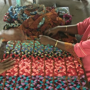Women in Kerala plait scraps into mattresses.