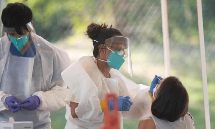 Medical technicians perform Covid-19 tests in Austin.