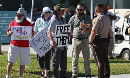 Police talk with demonstrators outside the Homestead facility.