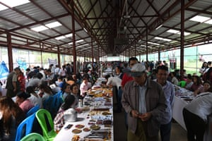 Sellers trading with buyers at the gems market in Mogok town, north of Mandalay