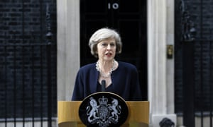 May outside No 10 on 13 July 13, her first day as PM.
