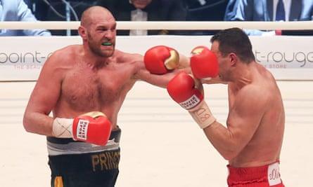 Tyson Fury (left) hits Vladimir Klitschko in the heavyweight world championships