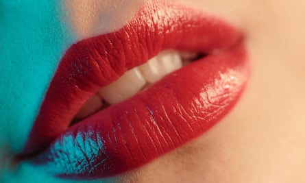Woman, human lips with red lipstick, close-up