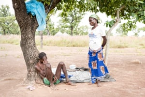 Elizabeth Kwamwe with her husband John Yimbilbe, who is chained to a tree