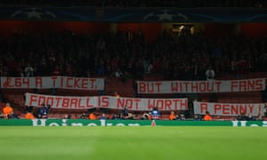 Bayern Munich fans display a banner protesting about the high price of tickets before their Champions League game against Arsenal in 2015