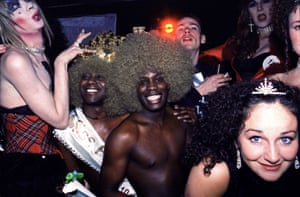 """Miss Flesh at the Haçienda, 1995 – Jon Shard """"On the far left is celebrated queer Mancunian performance artist David Hoyle with Afrodisiacs, a dance duo who were brought in to liven up proceedings. David continues to create chaos wherever he goes."""""""
