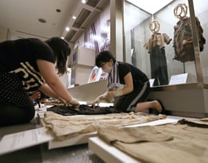 Staff at the Hiroshima Peace Memorial Museum clean exhibits before the 70th anniversary of the bombing last July