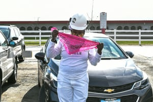 A Tyson Foods employee dons a second protective mask outside of the company's meat processing plant in Waterloo, Iowa.
