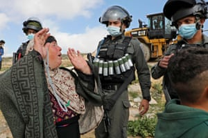 Hebron, West Bank. Palestinians react as Israeli authorities prepare to demolish a house in a village south of Yatta in the southern area of the town