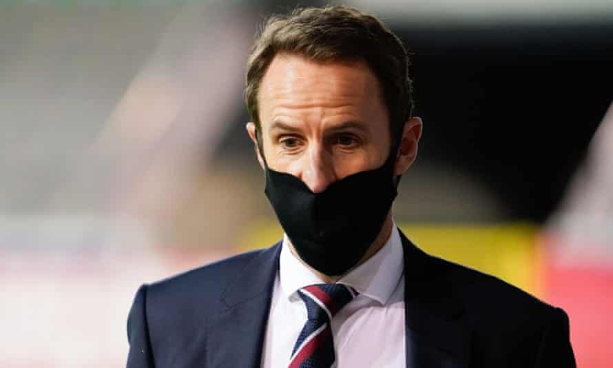 Gareth Southgate, pictured in Belgium on Sunday, says: 'The players want to play for England. They are in a really difficult situation.'