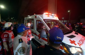 Members of the Mexican Red Cross work at the scene