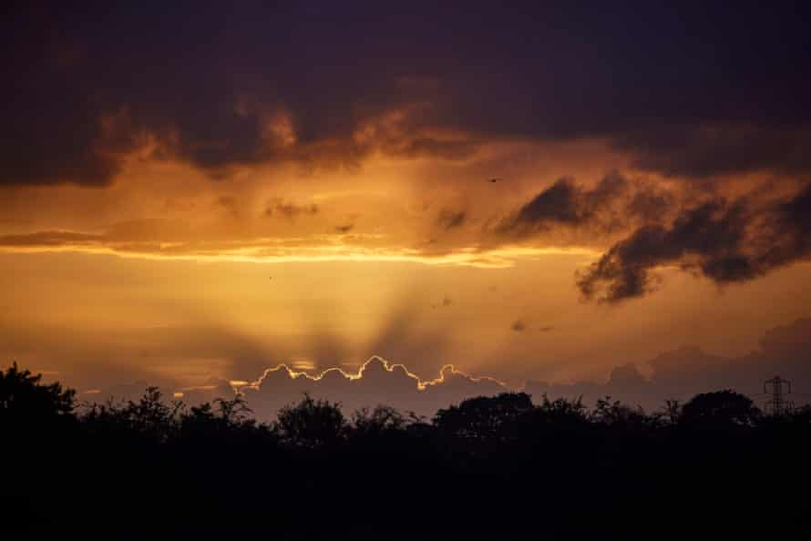 The sun sets over Glastonbury.
