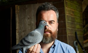 'I quickly came to love watching them fly': Jon Day with Paul, one of his pigeons.