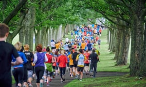 Runners in a wooded area of Woodhouse Moor, Leeds, taking part in a communal Parkrun.