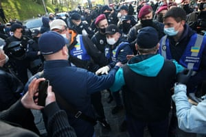 Police speak with small business owners holding a rally against the lockdown measures in Kiev, Ukraine